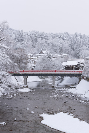 Red bridge of Takayama cover by snow in winter. Stock Photo