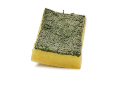 worn out: Worn out Srubber on the white background, yellow sponge with scrubber