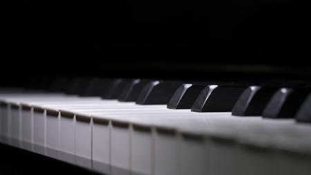 Close up Piano Keys background in low light toned, selective focused