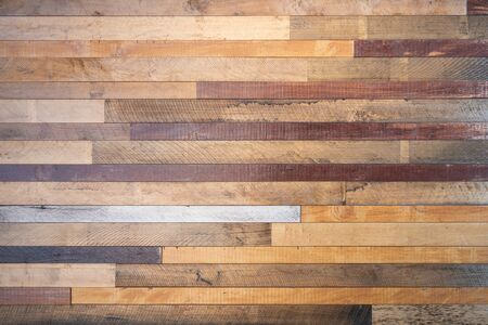 Various tone of wooden stripes use as wall partition or fence cladding in horizontal line which also use as building facade  decoration and household. Stockfoto