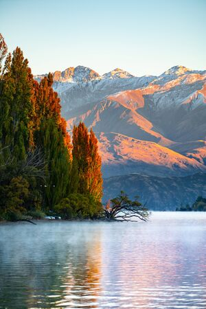 Scenic peace and colorful of lake wanaka and Mt. Aspiring at the back in the morning, One of tourist attraction places in New Zealand. the popular place in New Zealand that tourist must visit.