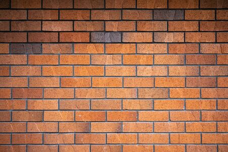 Horizontal brown brick wall for background and copy space.
