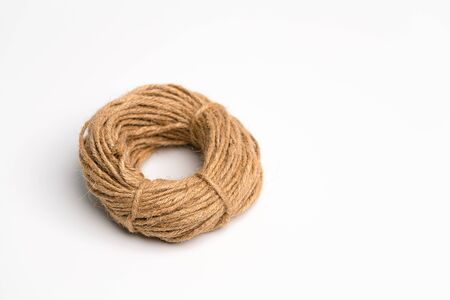 Top Side view of the roll of hemp rope isolate on the white background with copy space.