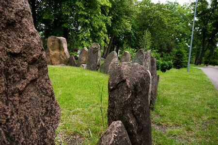 Megalithic stone circle Kriviy Rih city, Ukraine, city park. Summer time. Juicy grass among the ancient pagan sanctuary.