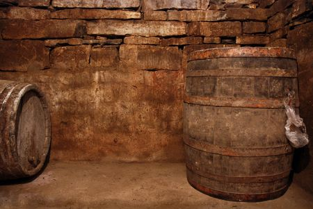 My own wine cellar filled with barrels filled with wine. Stock Photo