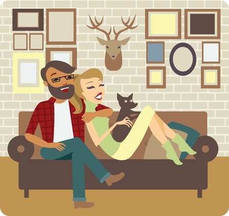 sitting on sofa: Young Couple Relaxing On Sofa In New Home