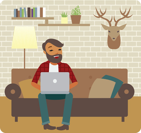 cozy: Young man freelancer working from cozy home