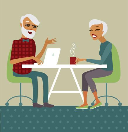 older woman smiling: Trendy senior couple using laptop drinking tea