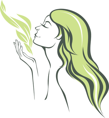 nature woman: The young woman inhales the smell of nature concept