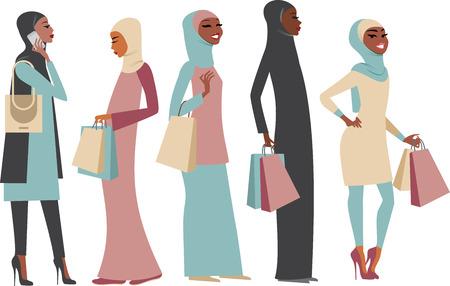 chicas de compras: Varias niñas árabes musulmanes con sus bolsas de compras
