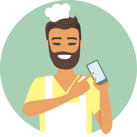 Young man chef with mobile device in his hand