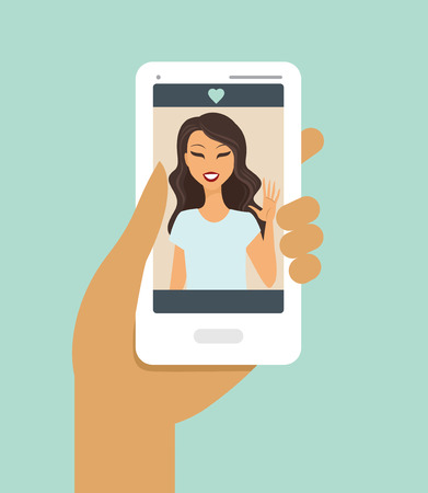 Closeup of a hand holding smartphone during a video call