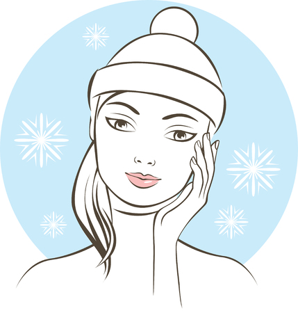 closeup contour portrait of young woman touching her face skin in winter season. Winter skin treatment concept