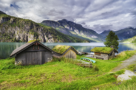 wooden house in strut lake Norway