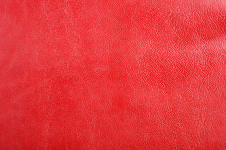 Natural red leather texture background. Abstract vintage sheepskin backdrop design.