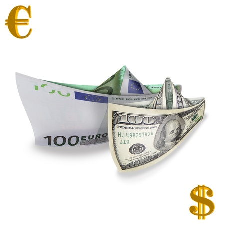 photography with scene of the dollar and euro in the manner of paper naves with gold symbols photo