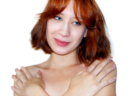 modesty: photography with scene of the beautiful girl with redheads hair on white background