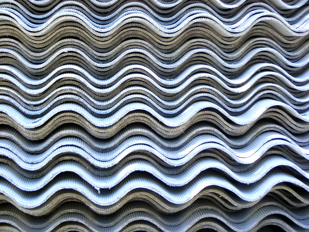 slate roof: photography with scene built in pile of wavy building slate