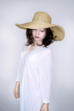 Woman with a hat on a background