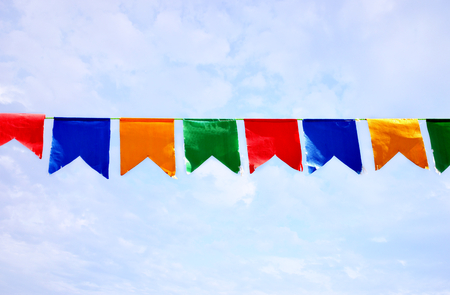 photography with scene colored small flags on background sky