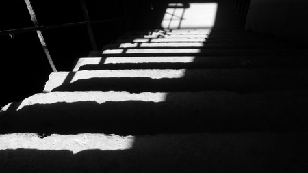 monochrome with a dark basement stairway in a ray of the light