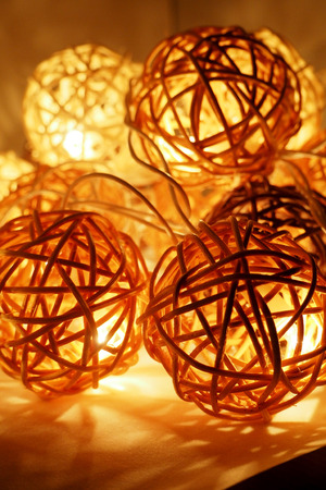 Daylight tone lamp in the wooden rattan ball.