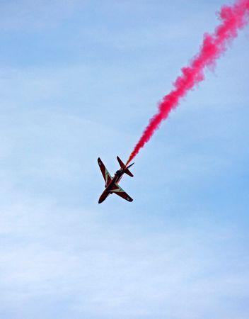 A Red Arrow RAF Airforce aerobatic, formation flying jet aeroplane photo