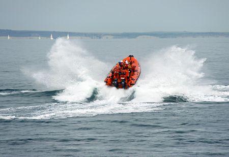 Orange lifeboat  life boat of the UK R.N.L.I. coastguard near Worthing Pier