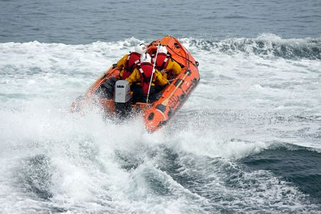 inshore: Lifeboat  life boat and crew of the R.N.L.I. coastguard near Worthing, UK