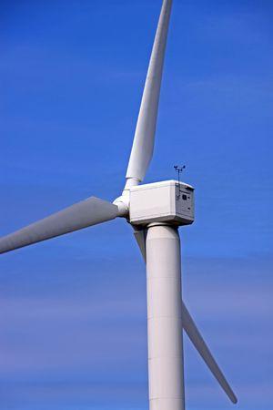 Wind turbine power generator mast and propellers on a wind farm photo