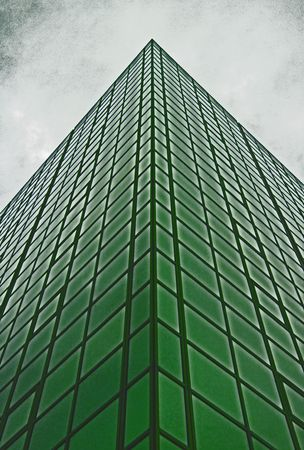 Urban city corporate office block building with many glass windows photo