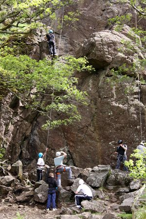 Climbers at a mountain rock face climbing in the Lake District