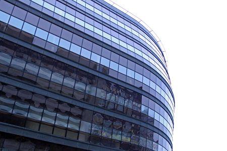 Glass windowed urban office building on white photo
