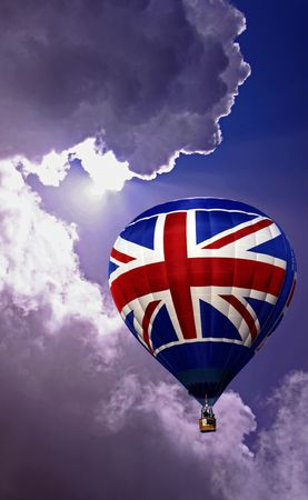 Colouful red white and blue hot air balloon rising in a cloudy sky Stock Photo - 5708673