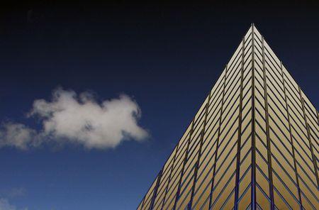 Glass windowed urban office sky scraper, blue sky and cloud photo