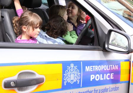 Balham, London, UK, May 16th 2009 children in a police car at a street party
