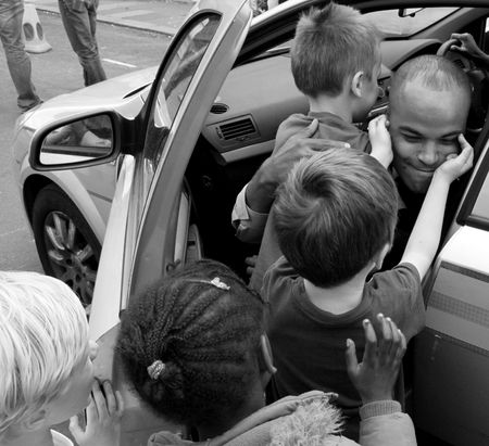 Balham, London, UK, May 16th 2009 British Police man and children at a street party