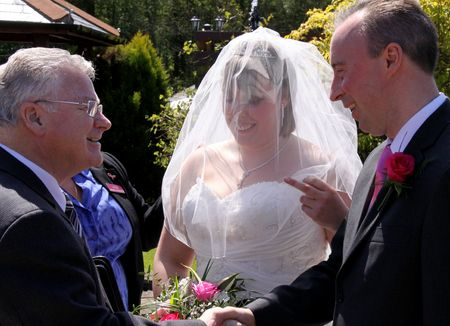 vicar: Gretna Green, Scotland, May 24th 2009, vicar  priest, bride and best man at the famous Gretna Green