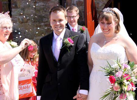gretna green: Gretna Green, Scotland, May 24th 2009, bride and groom and confetti  at the famous Gretna Green Editorial