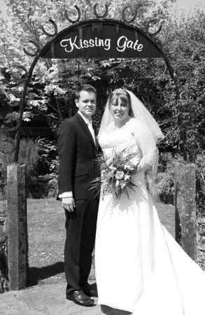 gretna green: Gretna Green, Scotland, May 24th 2009, bride and groom at the famous Gretna Green kissing gate