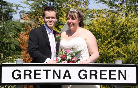 vicar: Gretna Green, Scotland, May 24th 2009, bride and groom at the famous Gretna Green Editorial