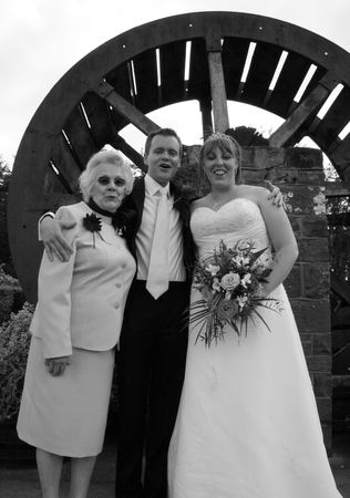 vicar: Gretna Green, Scotland, May 24th 2009, bride and groom and mother at the famous Gretna Green