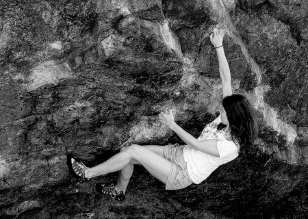 borrowdale: Keswick, The Lake District, Scotland, May 26th 2009, young woman climbing The Bowderstone Editorial