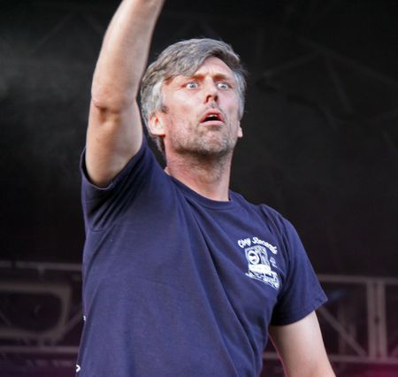 Guilfest Music Festival, Guildford, UK 12th July 2009 Mark Berry (Bez) of the Happy Mondays Indie band dancing on stage Stock Photo - 6886353