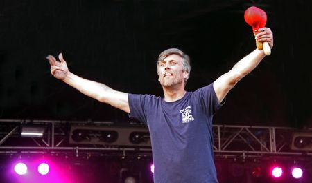 Guilfest Music Festival, Guildford, UK 12th July 2009 Mark Berry (Bez) of the Happy Mondays Indie band dancing on stage Stock Photo - 6886354