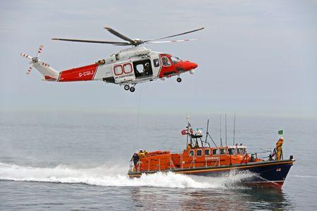 coastguard: Worthing Pier, Worthing, UK, 28th June 2009 lifeboat and helicopter of the UK R.N.L.I. coastguard