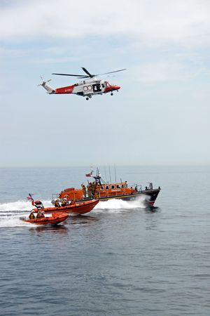 coastguard: Worthing Pier, Worthing, UK, 28th June 2009 lifeboat  lifeboat crew, dinghy and helicopter of the UK R.N.L.I. coastguard Editorial