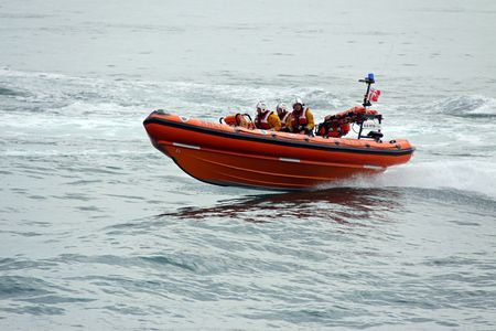 rescuing: Worthing Pier, Worthing, UK, 28th June 2009 lifeboat  life boat practice display of the UK R.N.L.I. coastguard on manoeuvres