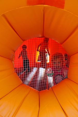 Tulleys Farm, Crawley, UK, 291009 Children having fun in a halloween pumpkin bouncy castle