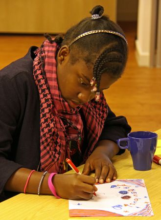 cva: C.V.A. Resource Centre, Croydon, London, UK, 9th September 2009 a young girl at the Faiths Together Group Meeting Editorial